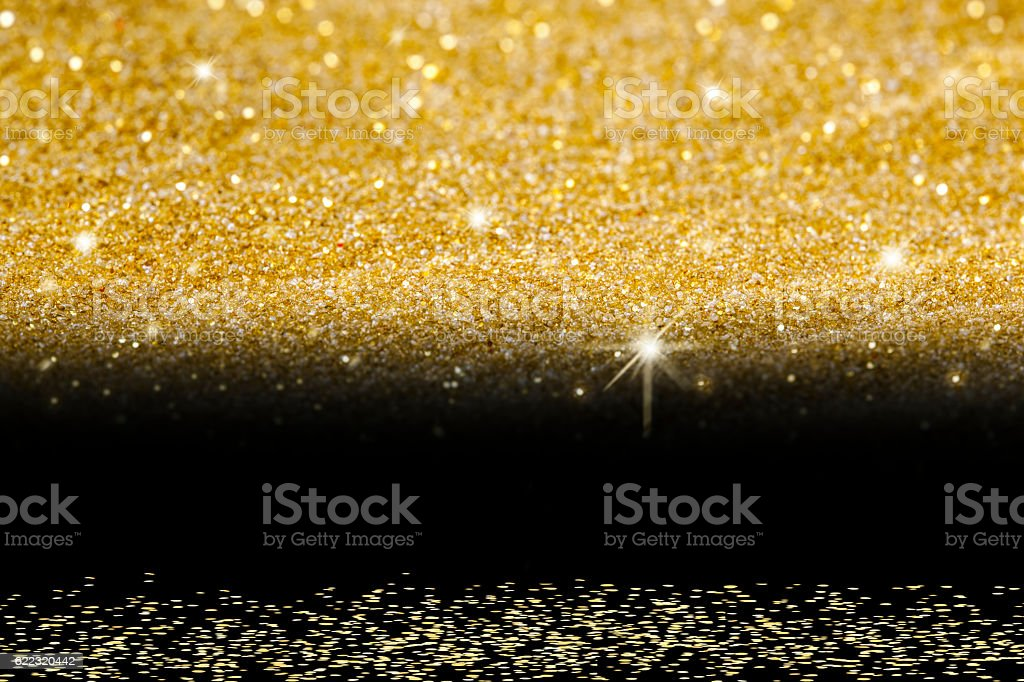 Golden Glitter on Black background. vector art illustration