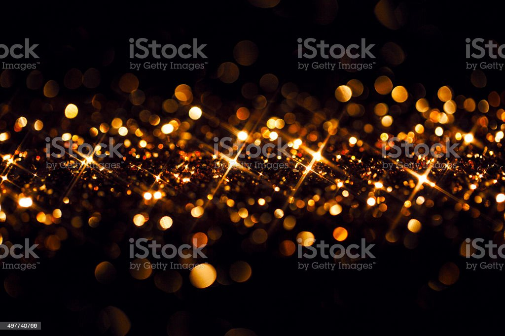 Golden Glitter on Black - Christmas Backgrounds Celebration stock photo