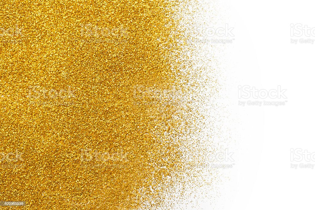 Golden glitter sand texture on white, abstract background. stock photo