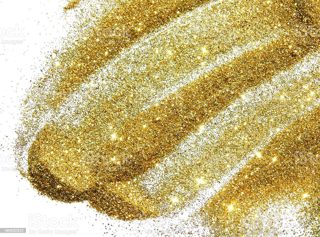 Golden glitter sparkle on white background stock photo