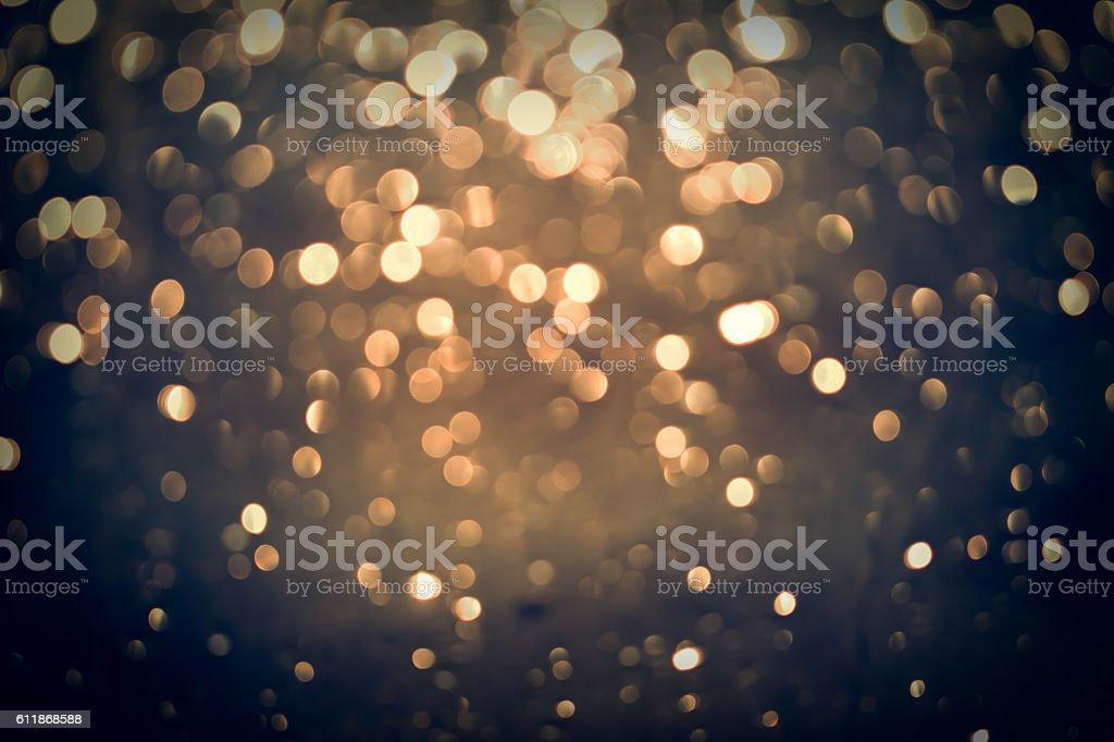 golden glittering bokeh background stock photo