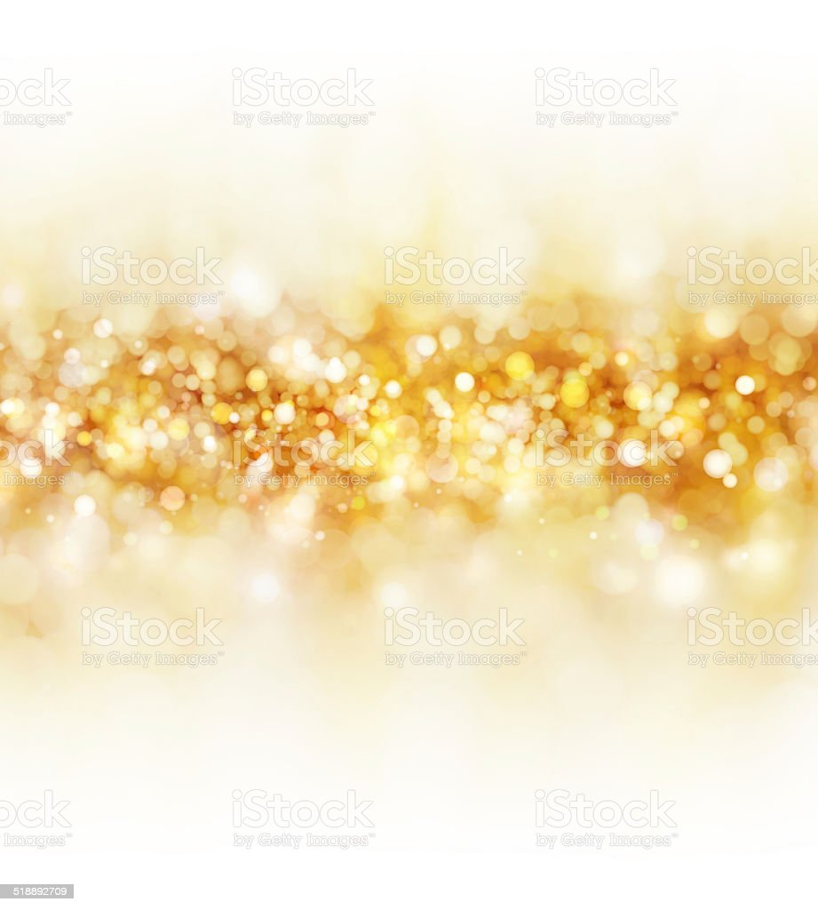 Golden glowing Christmas background with lights stock photo