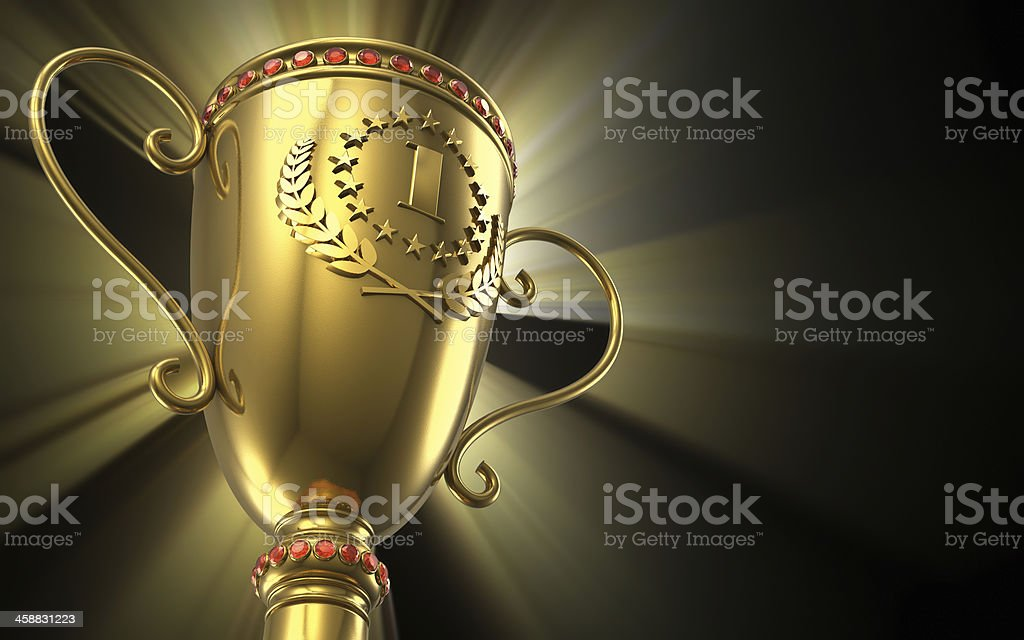 Golden glowing trophy cup on black background stock photo