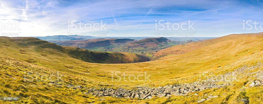 Golden grassland, green valley, blue sky royalty-free stock photo