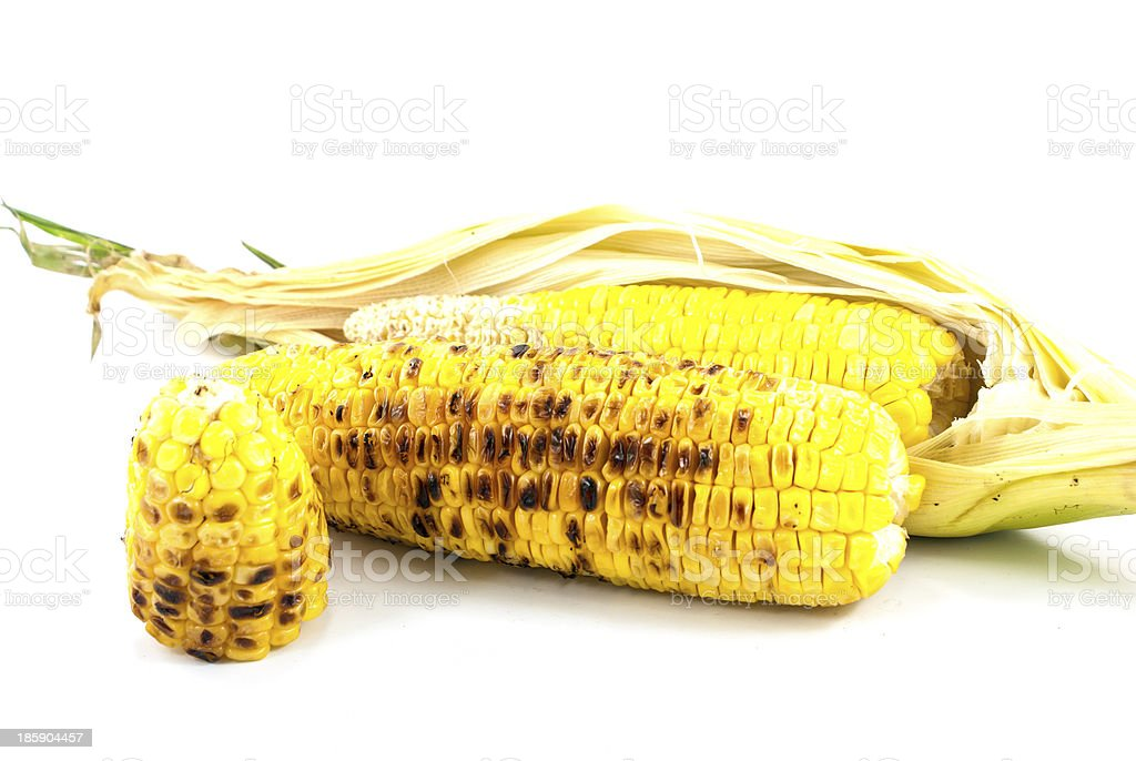 Golden grilled corn and ripe on white background royalty-free stock photo