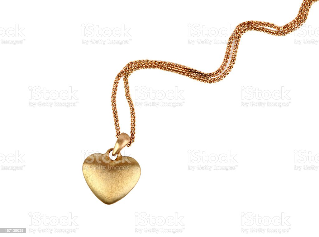 Golden heart pendant stock photo