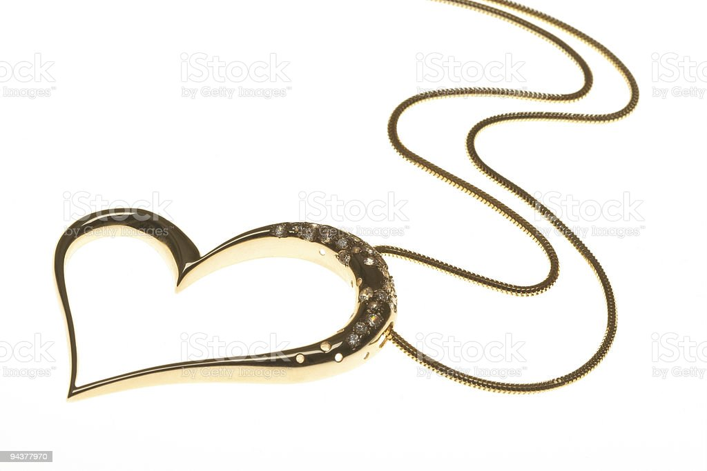 Golden heart shaped necklace on white background royalty-free stock photo