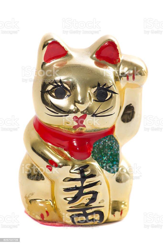 Golden japanese cat ceramic on white background stock photo