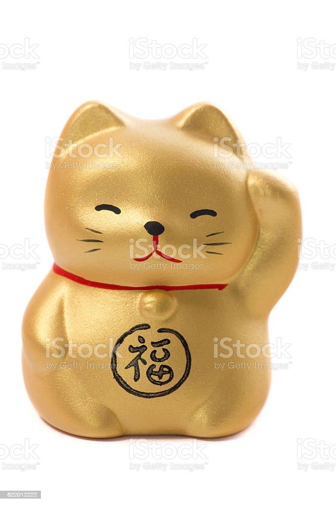 Golden japanese fat cat ceramic on white background stock photo