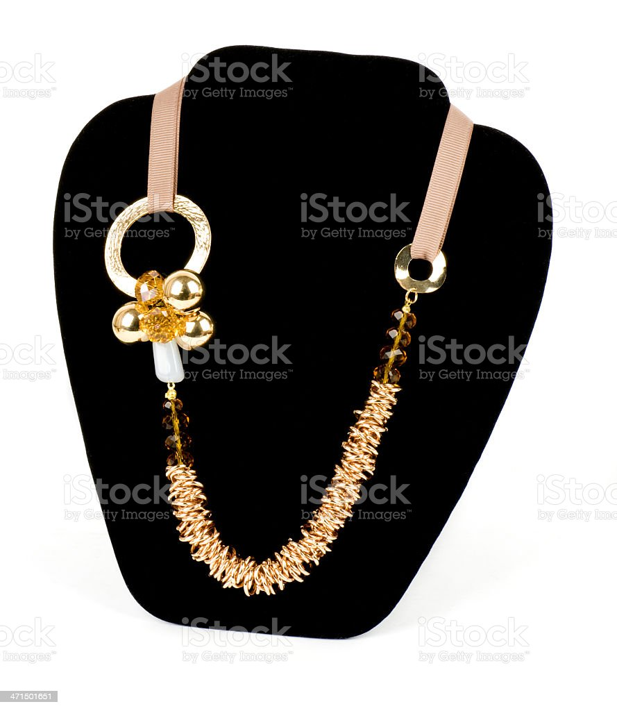 Golden jewelry on black background royalty-free stock photo