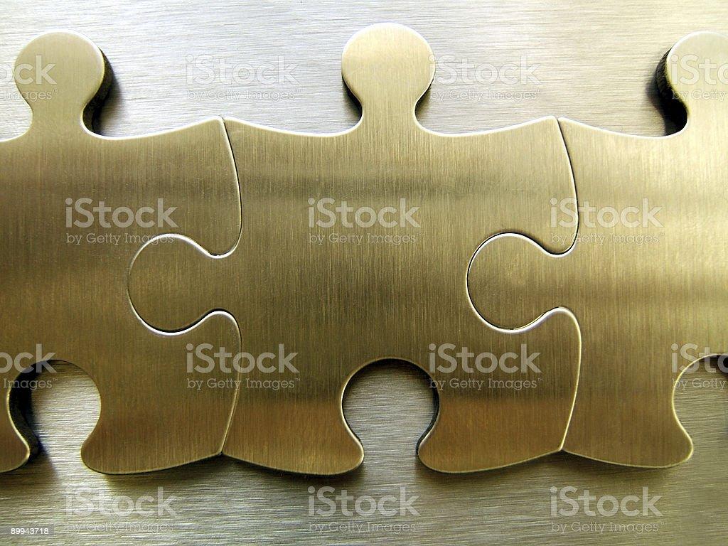 Golden jigsaw royalty-free stock photo