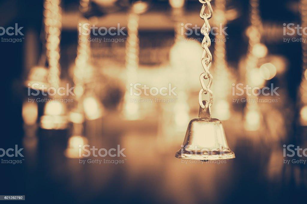 Golden jingle bells hanging in the dark background stock photo