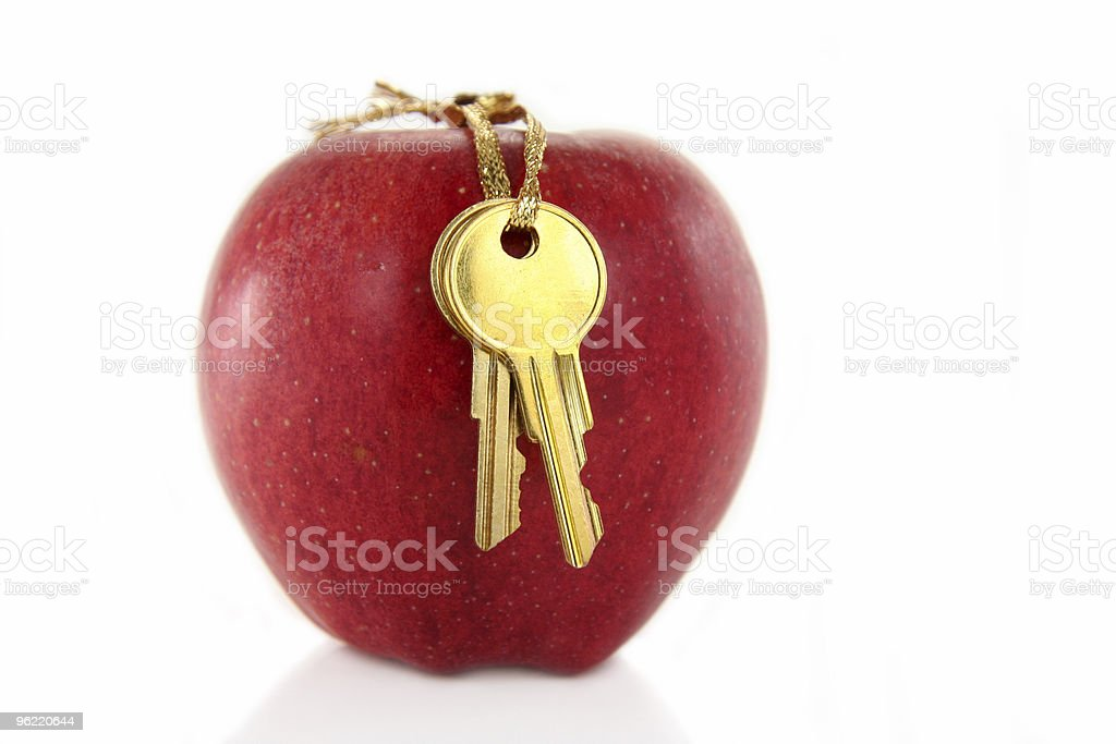 golden key and red apple royalty-free stock photo