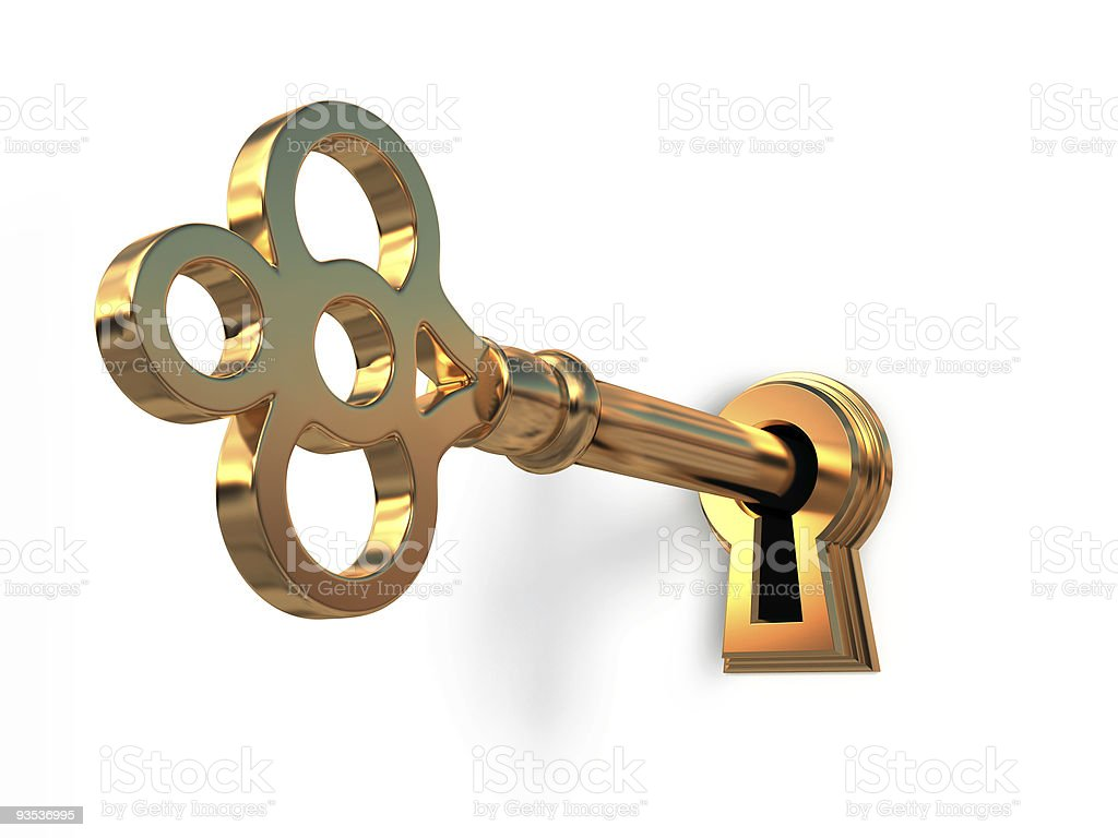Golden key in keyhole stock photo