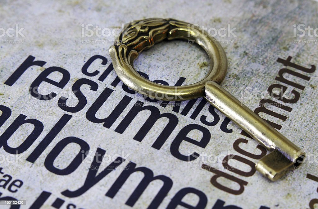 Golden key on resume text royalty-free stock photo
