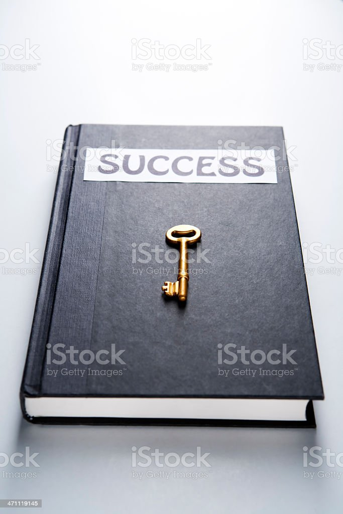 Golden key on success book royalty-free stock photo