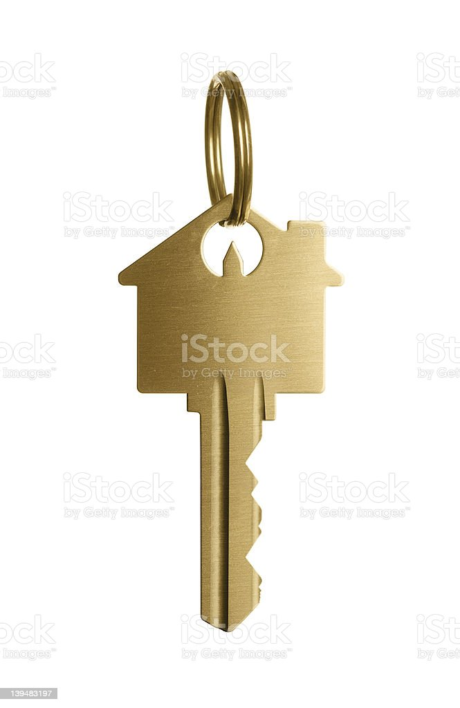 Golden key to a dream house stock photo
