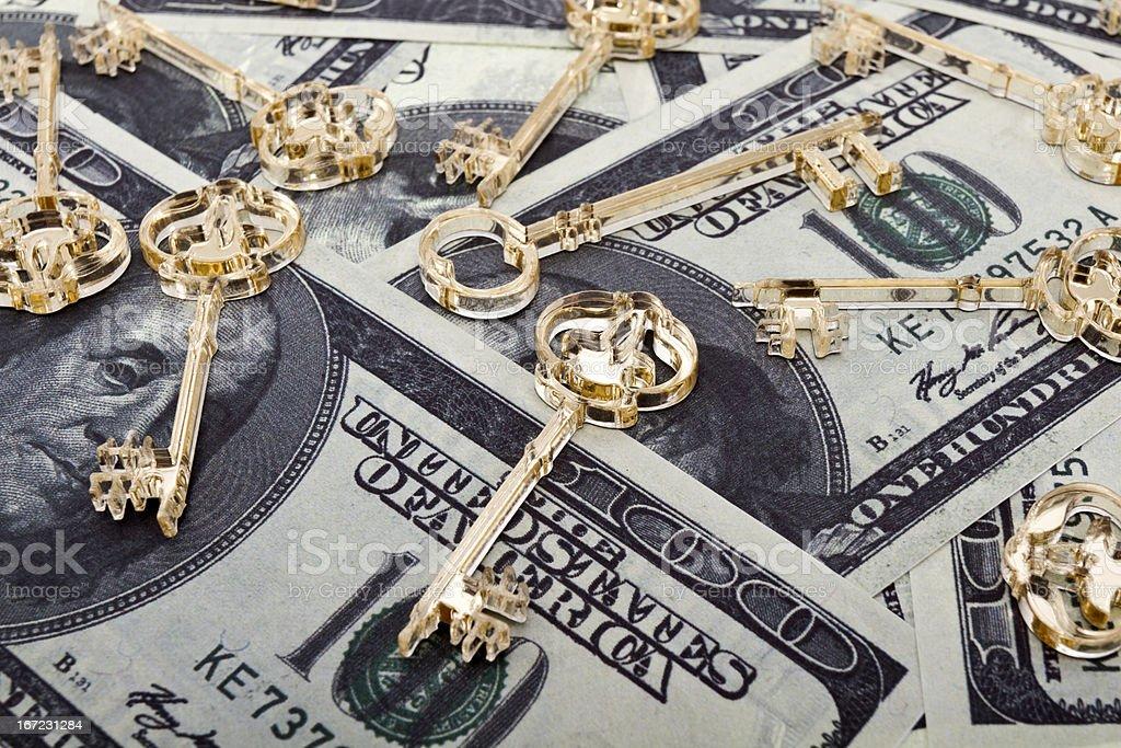 Golden keys on dollars royalty-free stock photo