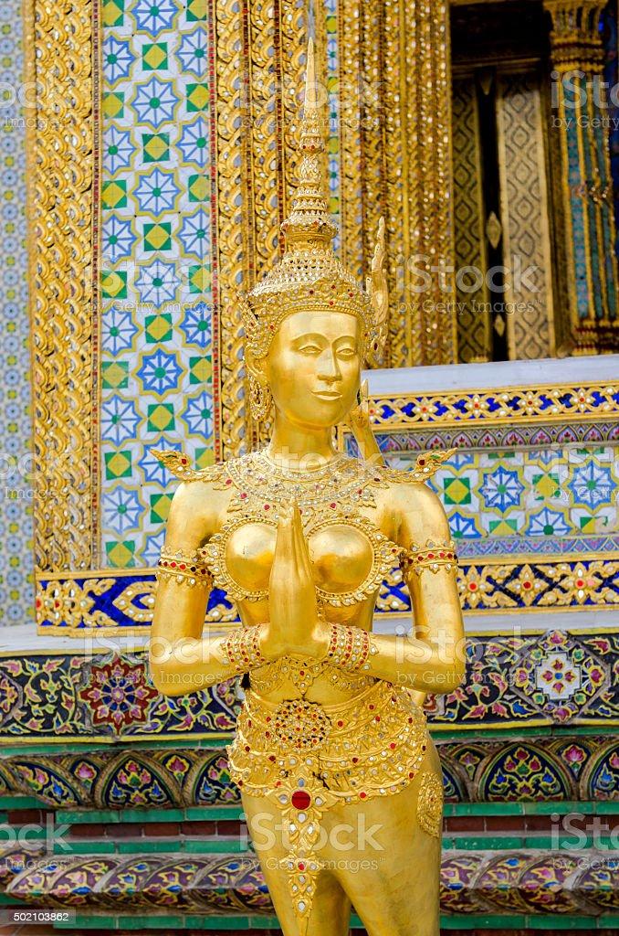 Golden Kinnaree in Wat Prakaew, Bangkok, Thailand. stock photo