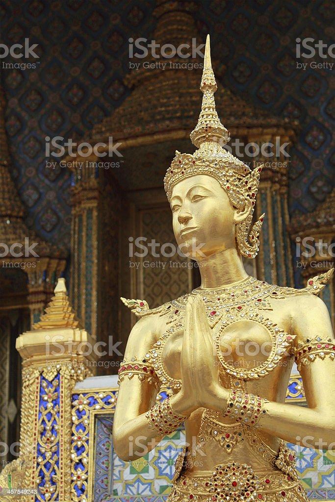 Golden Kinnari in Grand Palace, Thailand stock photo