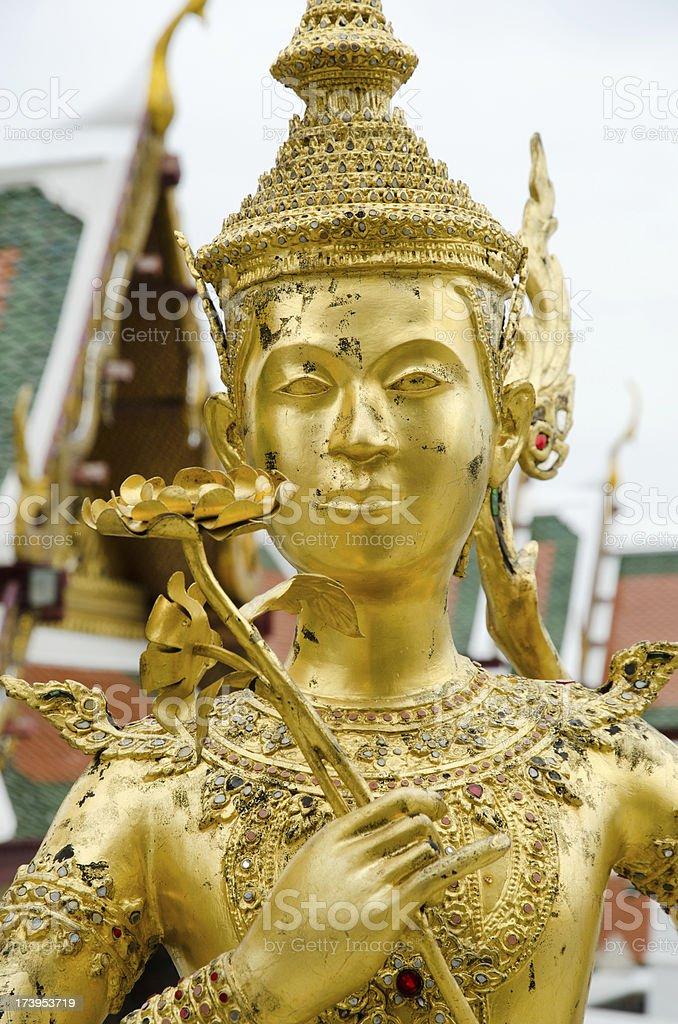 Golden kinnari statue at Wat Phra Kaew royalty-free stock photo