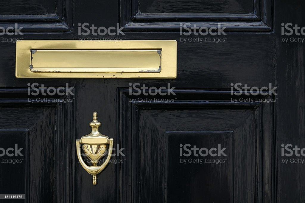 Golden letter box and door knocker stock photo