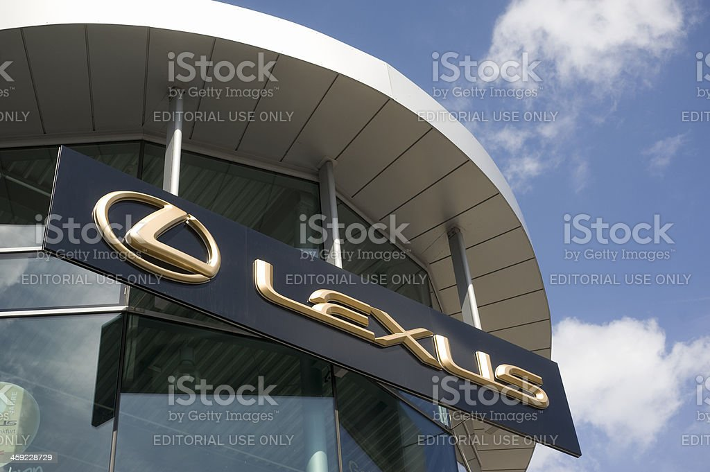 Golden Lexus signage on car retailer`s building stock photo