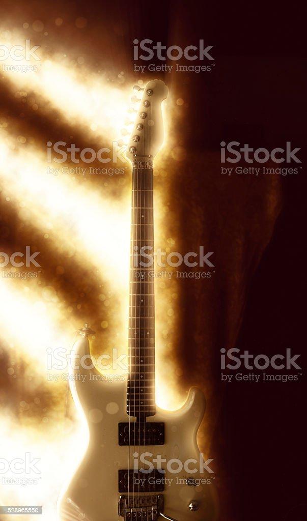 golden light beams on guitar stock photo