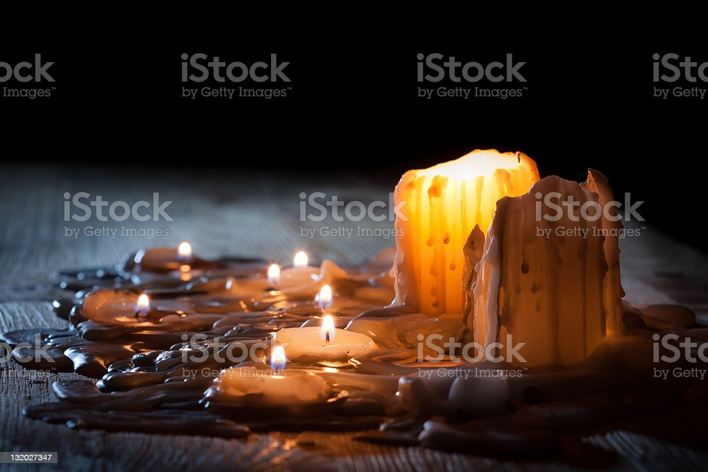 Golden light from burning candles stock photo