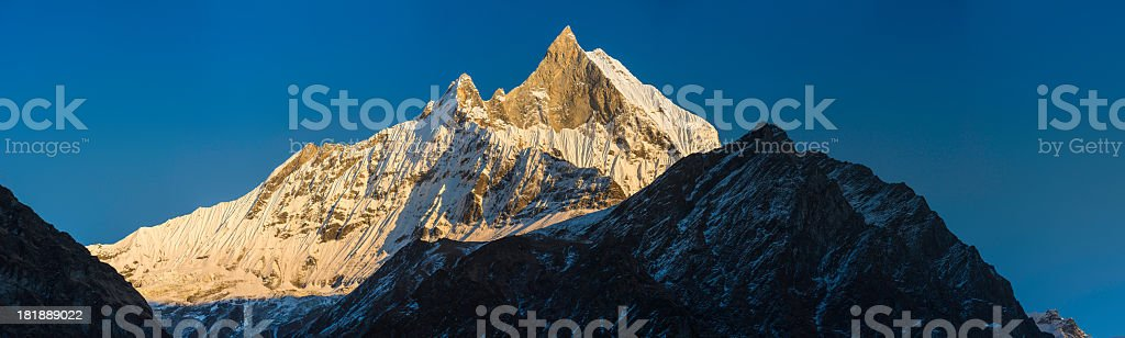 Golden light on incredible snow capped peaks panorama royalty-free stock photo