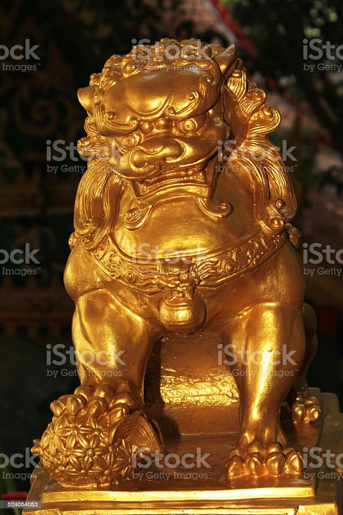 Golden Lion Chinese Statues stock photo