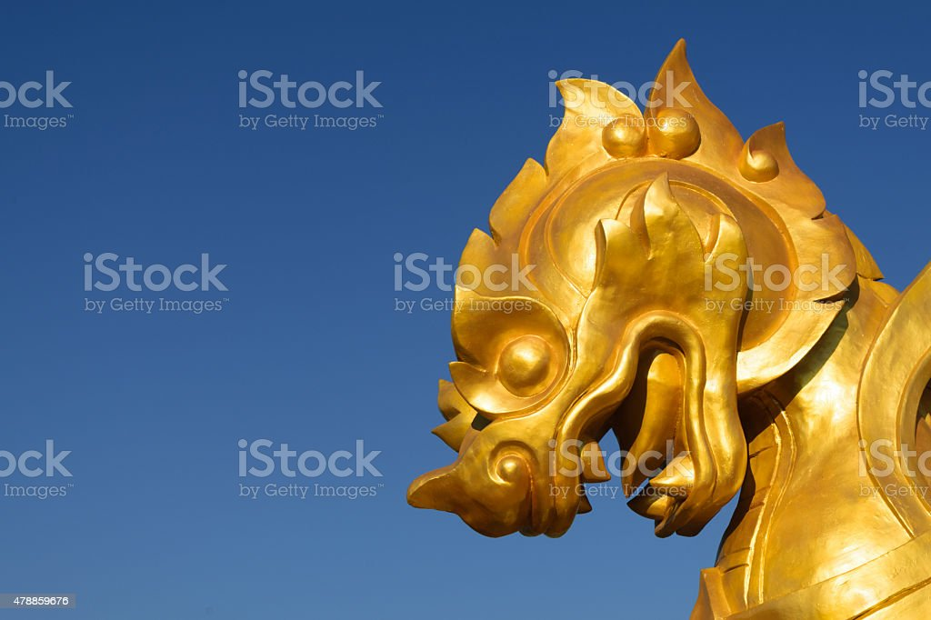 Golden lion head carving stock photo