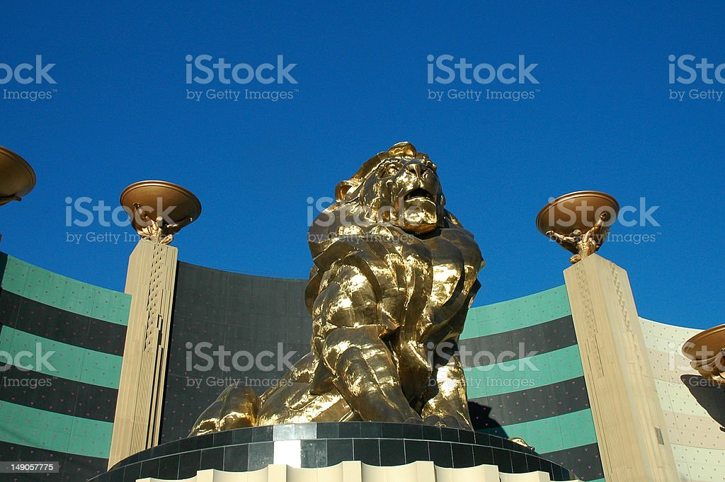 Golden Lion Statue on Stand stock photo