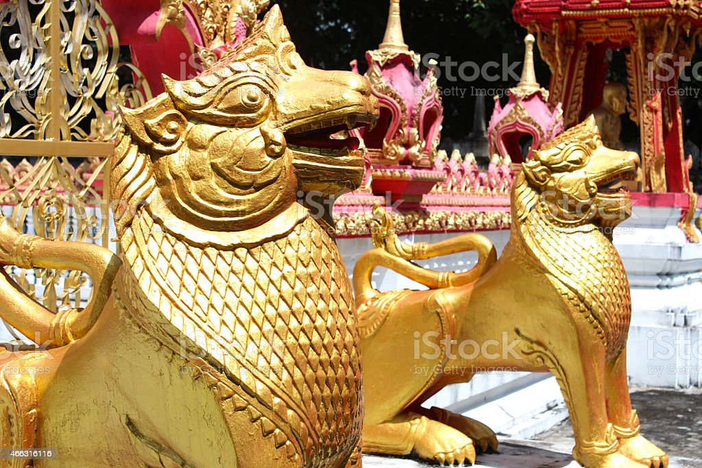 Golden Lions of Thai Temple stock photo