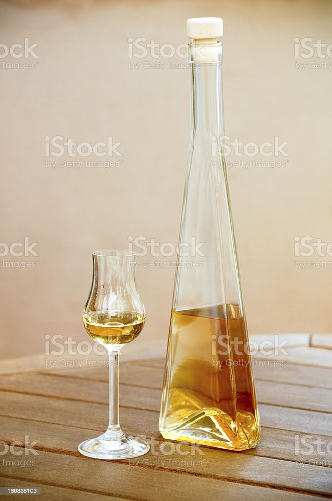 Golden liqueur, spirit bottle and glass royalty-free stock photo