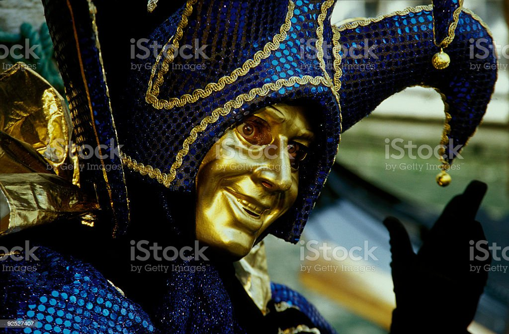Golden mask with harlequin costume at carnival in Venice (XXL) royalty-free stock photo
