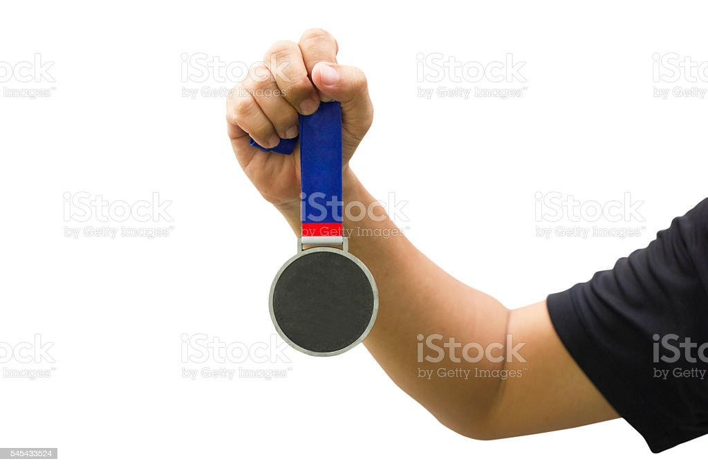 Golden Medal In Man Hand Isolated On White Background. stock photo