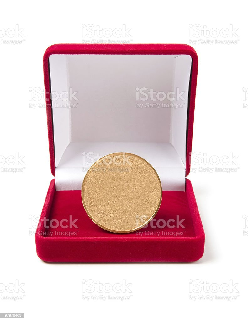Golden medal in red gift box royalty-free stock photo