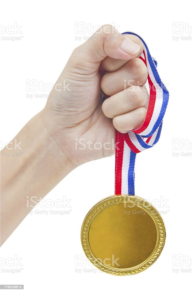 Golden medal in woman's hand isolated on white background. royalty-free stock photo