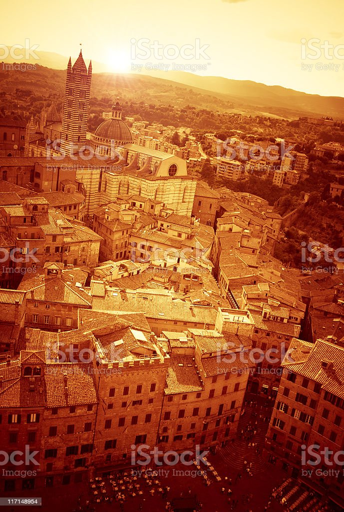 Golden medieval old Siena city panorama, aerial view at dusk royalty-free stock photo