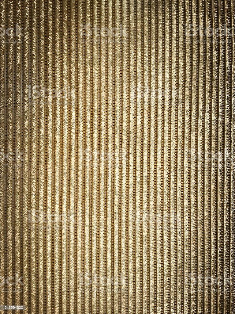 Golden metallic ribbed background stock photo