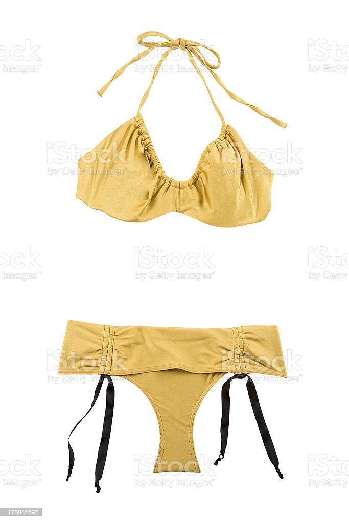 Golden metallized halter bikini with bows royalty-free stock photo