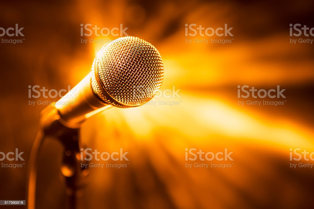 golden microphone on stage stock photo