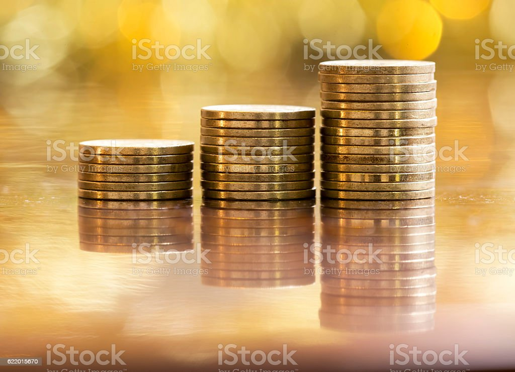Golden money coins stock photo