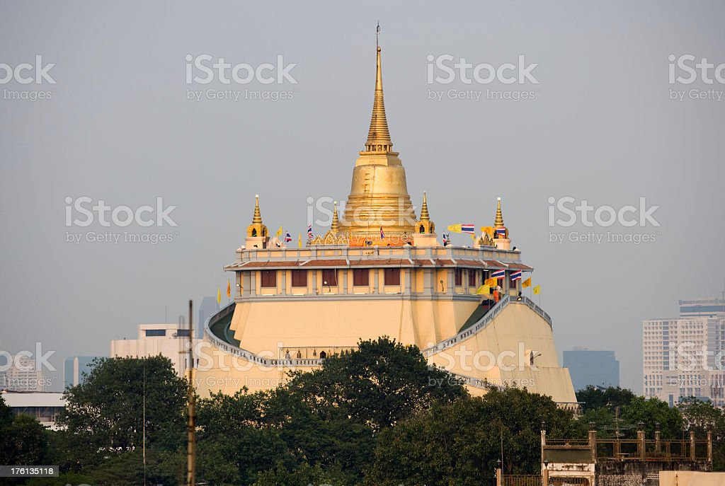 Golden Mount temple across the rooftops. stock photo
