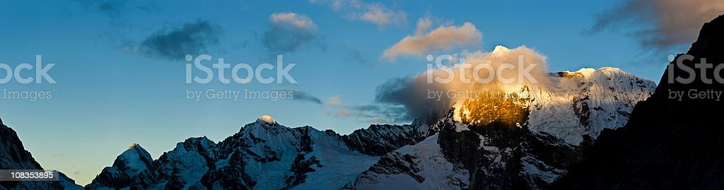 Golden mountain light snow summit glacier peaks panorama Himalayas Nepal stock photo