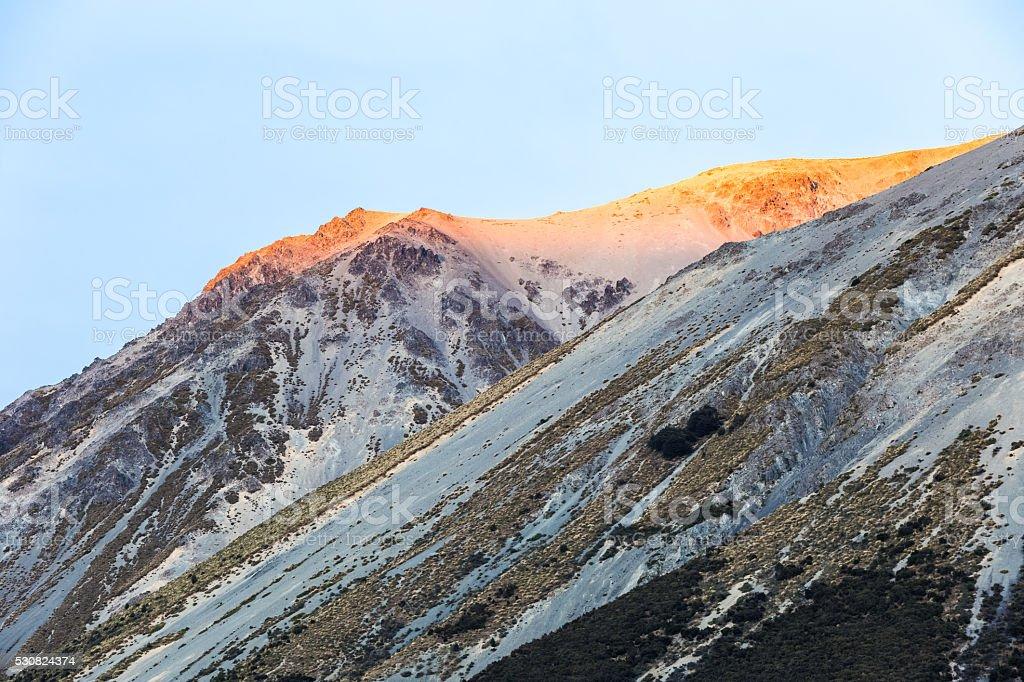 golden mountain peak with glacier stock photo