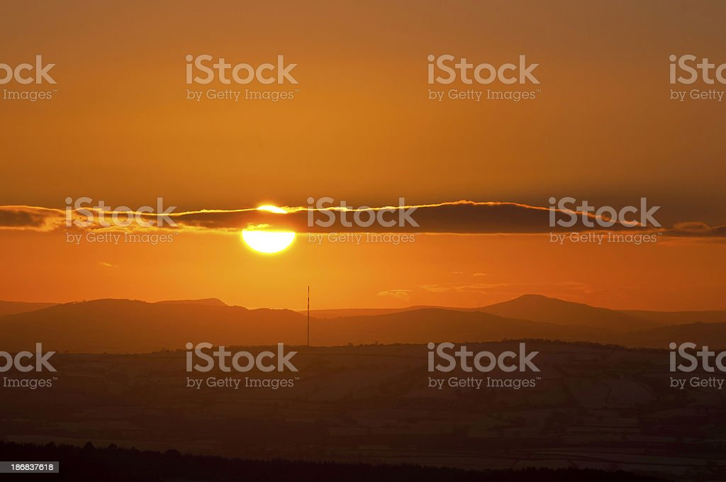 Golden mountain sunset misty ridges hill farms Wales UK stock photo