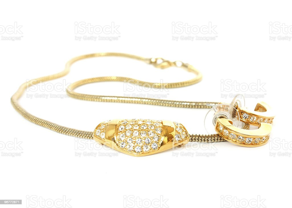 golden necklace and earrings royalty-free stock photo