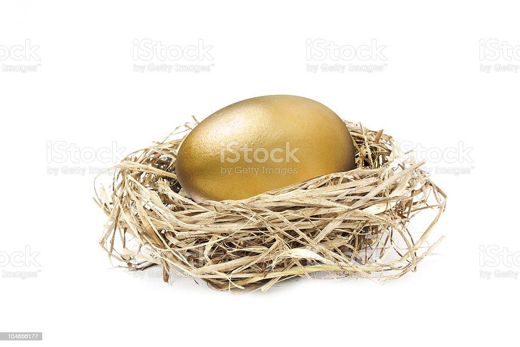 golden nest egg isolated on white stock photo
